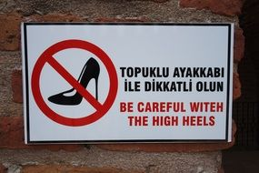 warning sign about high heels
