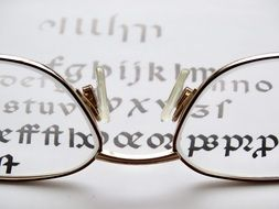 reading glasses and text