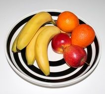 bananas, oranges and apples on the plate