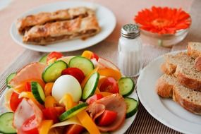Breakfast with fresh vegetables, egg and toast