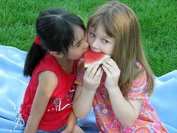 children eating a watermelon