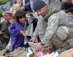 soldier help child gift new shoes