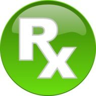 "White ""Rx"" letters on the green sign"