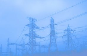 power masts and lines in mist