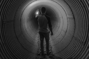 Black and white photo of the man in the tunnel