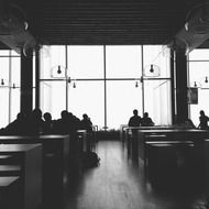 people in a restaurant in black and white image