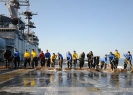 team cleaning of a flight deck