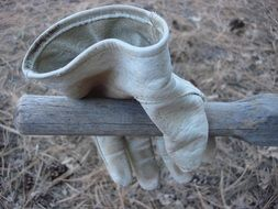 protective leather glove on wooden handle outdoor