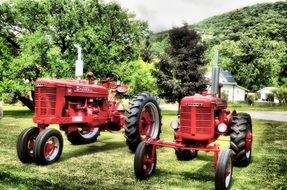 Two red tractors in the farm