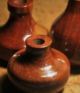 three wooden vases