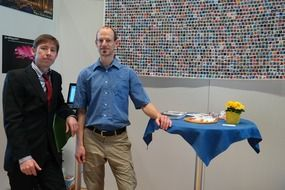 colleagues at trade fair stand