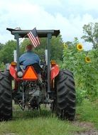 American farmer on a tractor in a rural field