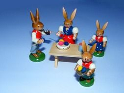 easter hares as colorful wooden figurines