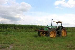 green tractor on agricultural field