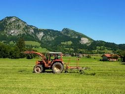 Red tractors on a field in Germany