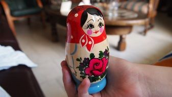 traditional russian wooden toy, matryoshka in hand