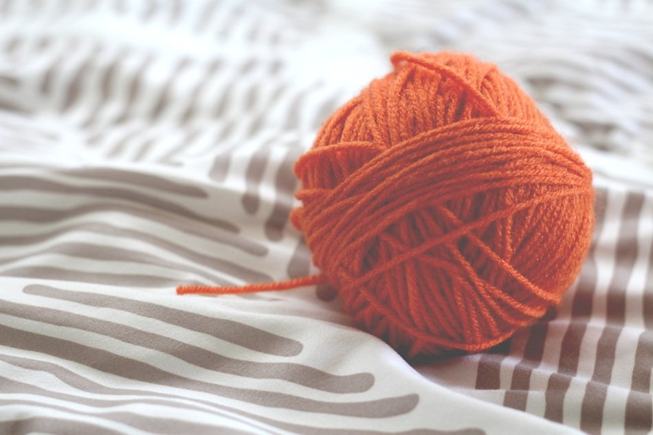 Orange wool ball for knitting