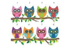 picture of colored owls on the branches