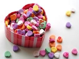 heart-shaped box with colored sweets