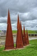 rusty metal cones on green grass in the port
