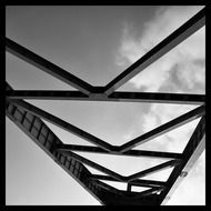 Steel beams against the blue sky