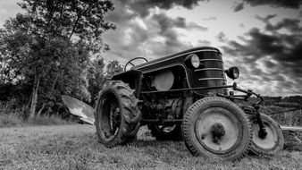 tractor in the field in black and white