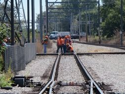 workers lay the rails