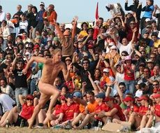 naked athlete on the beach in Rimini