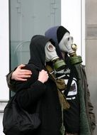 a couple of people in gas masks
