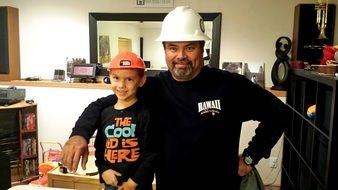 Happy son and father are construction workers