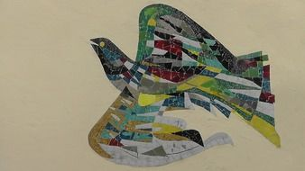 colorful bird made of mosaic