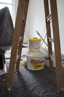Stepladder and paint on the background of the room repair