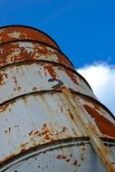 photo of a rusty industrial barrel