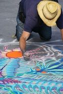 the artist draws with chalk
