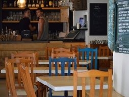 wooden tables and chairs in a cafe