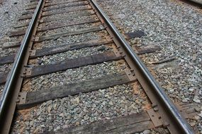 railroad tracks on gravel close up
