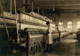 vintage photo, child girl working on textile mill