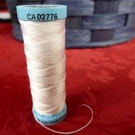 white sewing thread spool