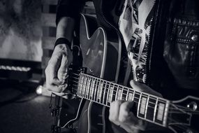 black and white photo of guitar player