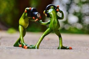 frogs with headphones dancing and posing