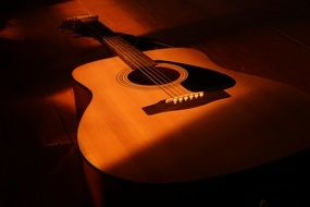 A guitar in the glare of light