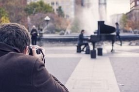 photographer photographs of a street musician