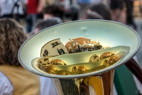 reflection of the street in a musical instrument