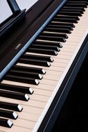 black and white piano keys close-up