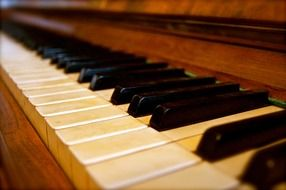 keys on a wooden piano