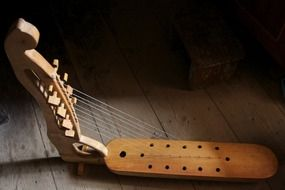 Photo of wooden musical instrument,harp
