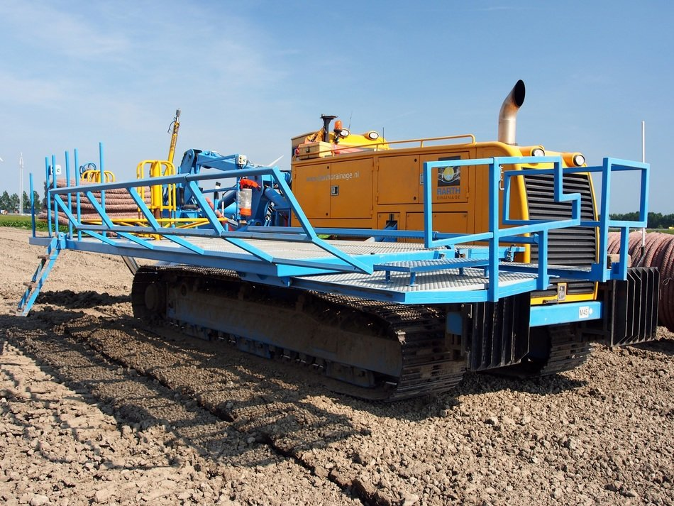 Earth-moving machine among the field