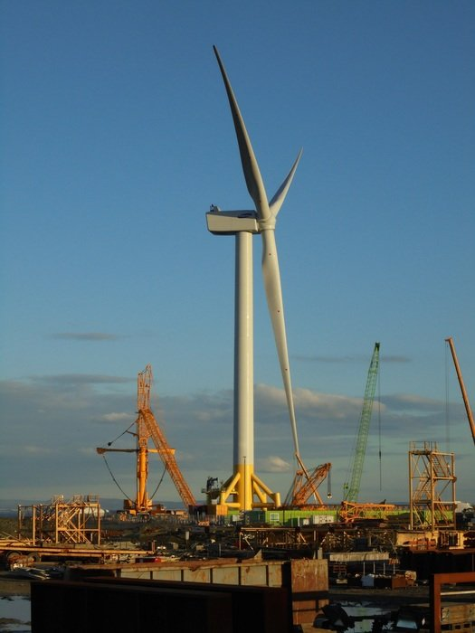 Wind turbine against the background of an industrial district