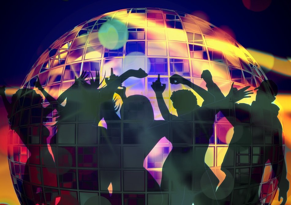 Silhouettes of people on the move against the background of a disco