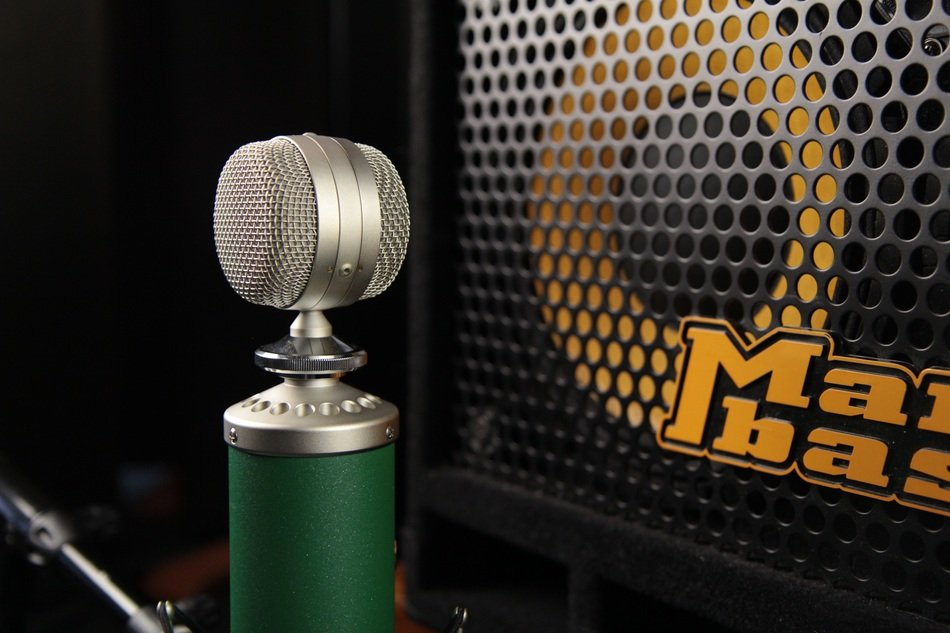 Microphone with a green stand in the studio